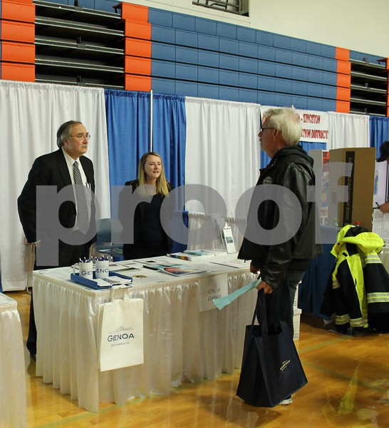 Genoa City administrative consultant Joe Misurelli (from left) and staff intern Alyssa Seguss speak with an area residents at the Genoa Area Chamber of Commerce Home and Business Expo on Saturday at Genoa-Kingston High School.