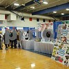 Genoa area residents browse booths at the Genoa Area Chamber of Commerce Home and Business Expo on Saturday at Genoa-Kingston High School.