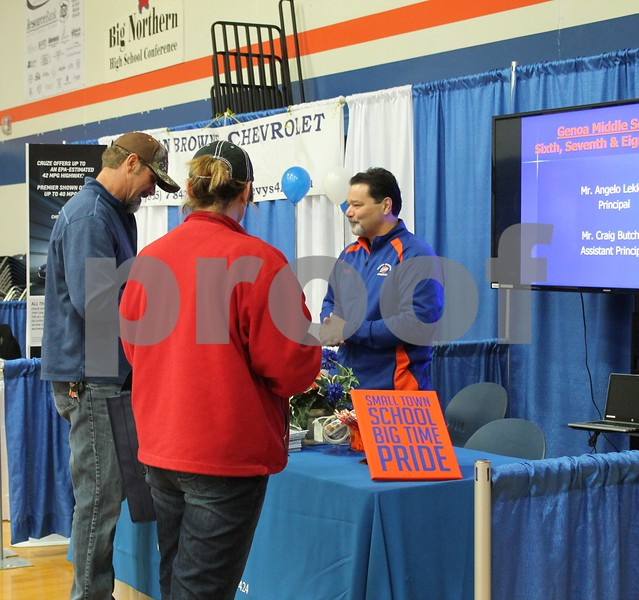Genoa-Kingston Middle School Principal Angelo Lekka (right) speaks with area residents at the Genoa Area Chamber of Commerce Home and Business Expo on Saturday at Genoa-Kingston High School.