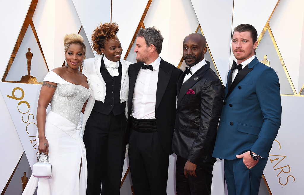 . Mary J. Blige, from left, Dee Rees, Jason Clarke, Rob Morgan, and Garrett Hedlund arrive at the Oscars on Sunday, March 4, 2018, at the Dolby Theatre in Los Angeles. (Photo by Jordan Strauss/Invision/AP)