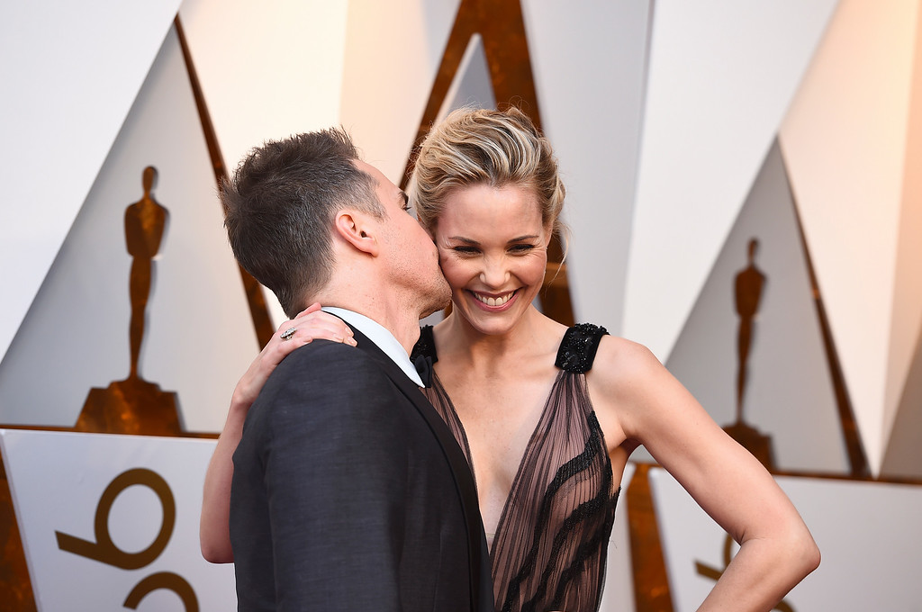 . Sam Rockwell, left, and Leslie Bibb arrive at the Oscars on Sunday, March 4, 2018, at the Dolby Theatre in Los Angeles. (Photo by Jordan Strauss/Invision/AP)
