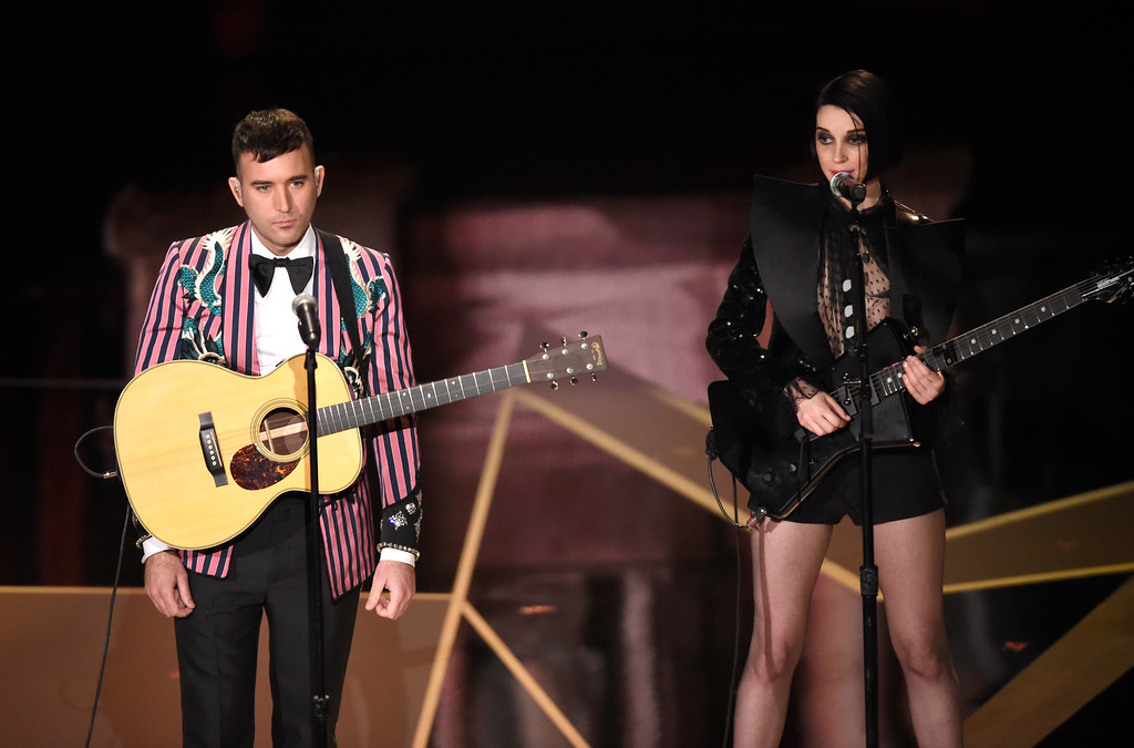 ". Sufjan Stevens, left, and St. Vincent perform ""Mystery of Love\"" from the film \""Call Me By Your Name\"" at the Oscars on Sunday, March 4, 2018, at the Dolby Theatre in Los Angeles. (Photo by Chris Pizzello/Invision/AP)"