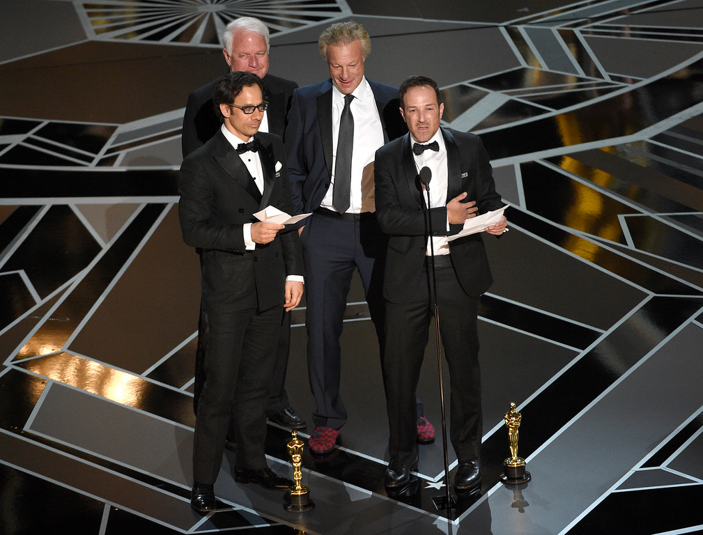 ". Dan Cogan, from left, James R. Swartz, David Fialkow, and Bryan Fogel accept the award for best documentary feature for ""Icarus\"" at the Oscars on Sunday, March 4, 2018, at the Dolby Theatre in Los Angeles. (Photo by Chris Pizzello/Invision/AP)"
