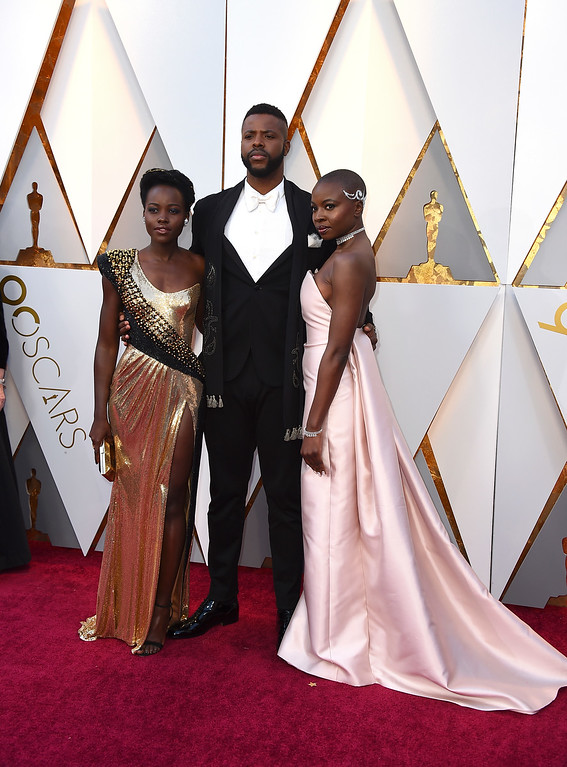 . Lupita Nyong\'o, from left, Winston Duke, and Danai Gurira arrive at the Oscars on Sunday, March 4, 2018, at the Dolby Theatre in Los Angeles. (Photo by Jordan Strauss/Invision/AP)