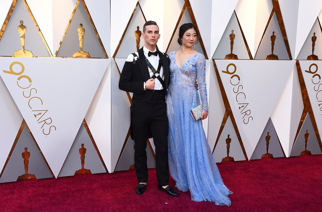 . Adam Rippon, left, and Mirai Nagasu arrive at the Oscars on Sunday, March 4, 2018, at the Dolby Theatre in Los Angeles. (Photo by Jordan Strauss/Invision/AP)