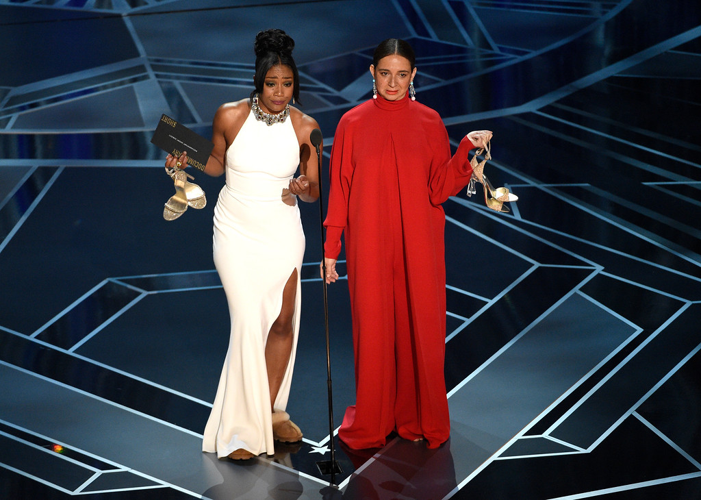 . Tiffany Haddish, left, and Maya Rudolph present the award for best documentary short subject at the Oscars on Sunday, March 4, 2018, at the Dolby Theatre in Los Angeles. (Photo by Chris Pizzello/Invision/AP)