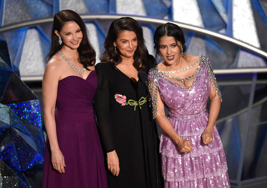 . Ashley Judd, from left, Annabella Sciorra and Salma Hayek speak at the Oscars on Sunday, March 4, 2018, at the Dolby Theatre in Los Angeles. (Photo by Chris Pizzello/Invision/AP)