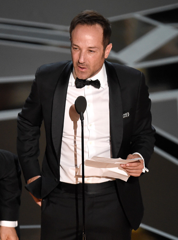 ". Bryan Fogel accepts the award for best documentary feature for ""Icarus\"" at the Oscars on Sunday, March 4, 2018, at the Dolby Theatre in Los Angeles. (Photo by Chris Pizzello/Invision/AP)"