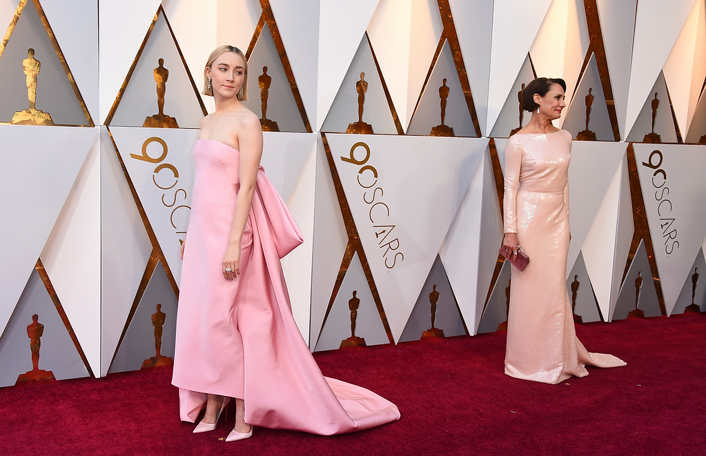 . Saoirse Ronan, left, and Laurie Metcalf arrive at the Oscars on Sunday, March 4, 2018, at the Dolby Theatre in Los Angeles. (Photo by Jordan Strauss/Invision/AP)