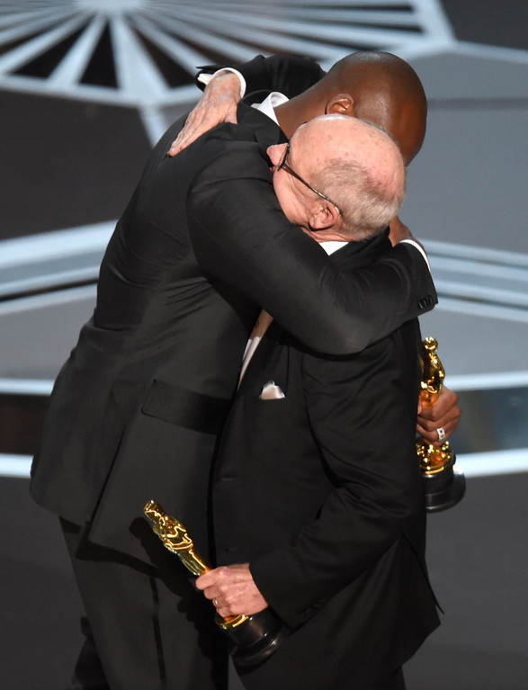 ". Kobe Bryant, left, embraces Glen Keane as they accept the award for best animated short for ""Dear Basketball\"" at the Oscars on Sunday, March 4, 2018, at the Dolby Theatre in Los Angeles.(Photo by Chris Pizzello/Invision/AP)"
