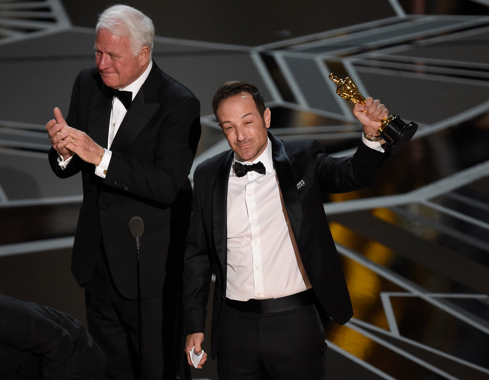 ". James R. Swartz, left, and Bryan Fogel accept the award for best documentary feature for ""Icarus\"" at the Oscars on Sunday, March 4, 2018, at the Dolby Theatre in Los Angeles. (Photo by Chris Pizzello/Invision/AP)"