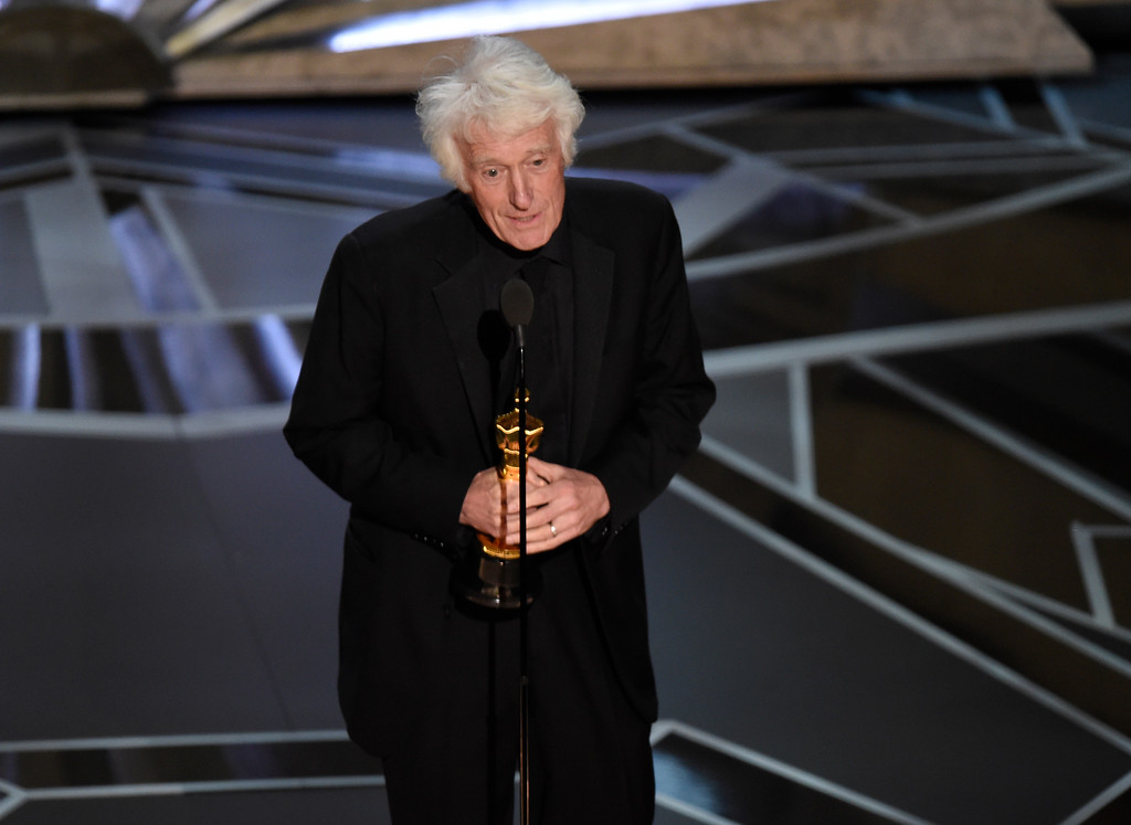 ". Roger Deakins accepts the award for best cinematography for ""Blade Runner\"" at the Oscars on Sunday, March 4, 2018, at the Dolby Theatre in Los Angeles. (Photo by Chris Pizzello/Invision/AP)"