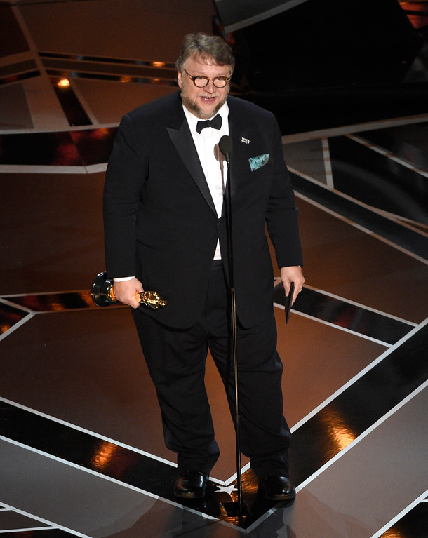 ". Guillermo del Toro accepts the award for best director for ""The Shape of Water\"" at the Oscars on Sunday, March 4, 2018, at the Dolby Theatre in Los Angeles. (Photo by Chris Pizzello/Invision/AP)"
