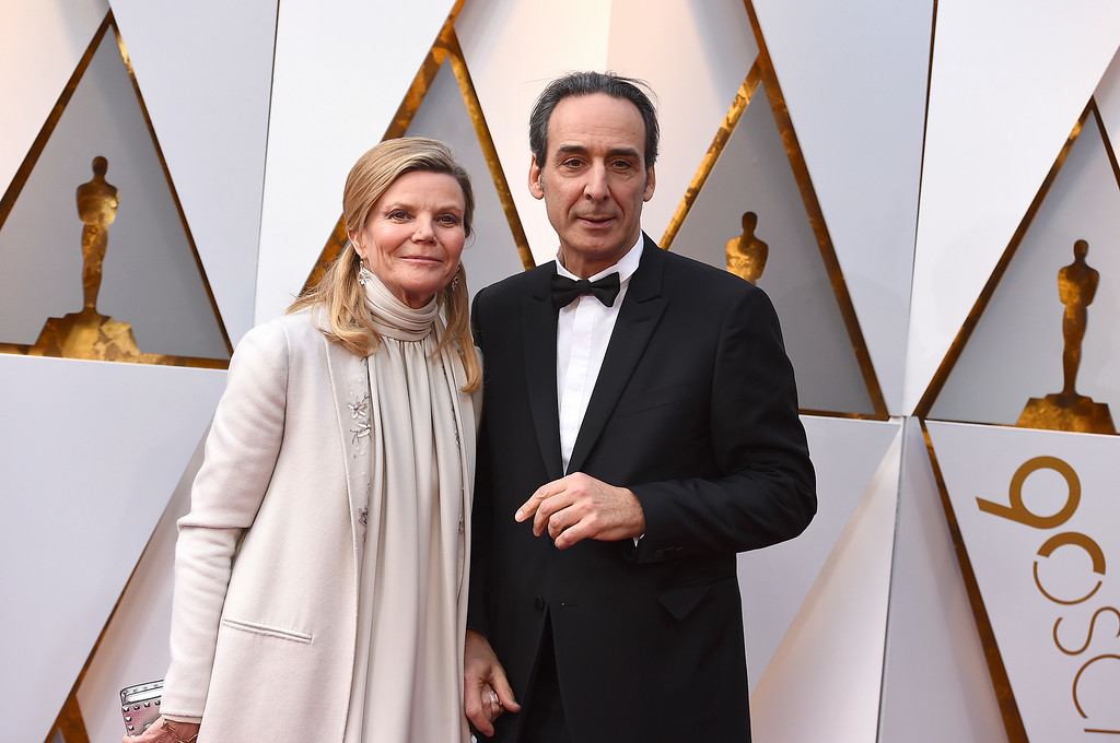 . Dominique Lemonnier, left, and Alexandre Desplat arrive at the Oscars on Sunday, March 4, 2018, at the Dolby Theatre in Los Angeles. (Photo by Jordan Strauss/Invision/AP)