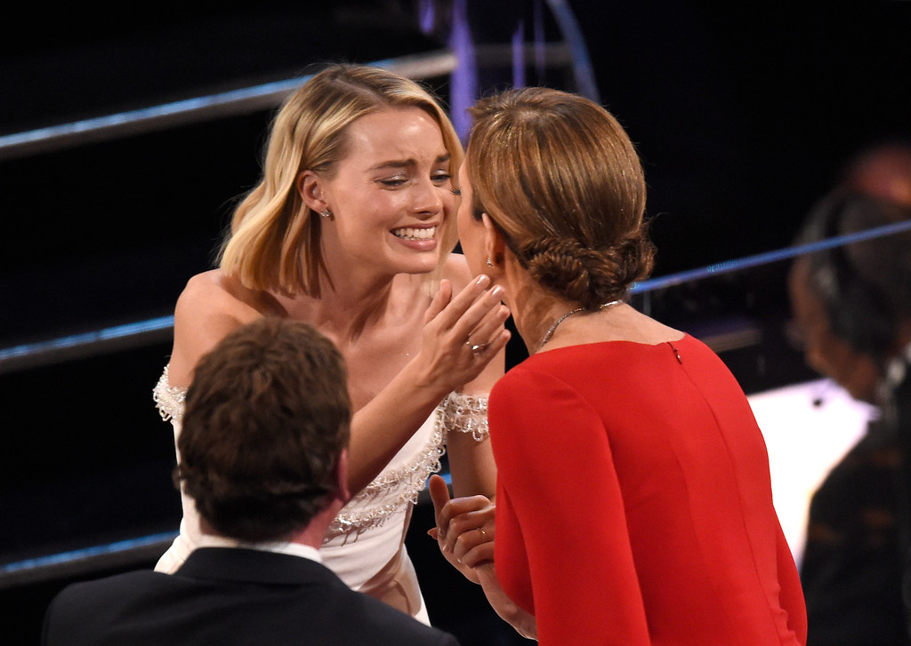 ". Margot Robbie, left, congratulates Allison Janney, winner of the award for best performance by an actress in a supporting role for ""I, Tonya\"" at the Oscars on Sunday, March 4, 2018, at the Dolby Theatre in Los Angeles. (Photo by Chris Pizzello/Invision/AP)"