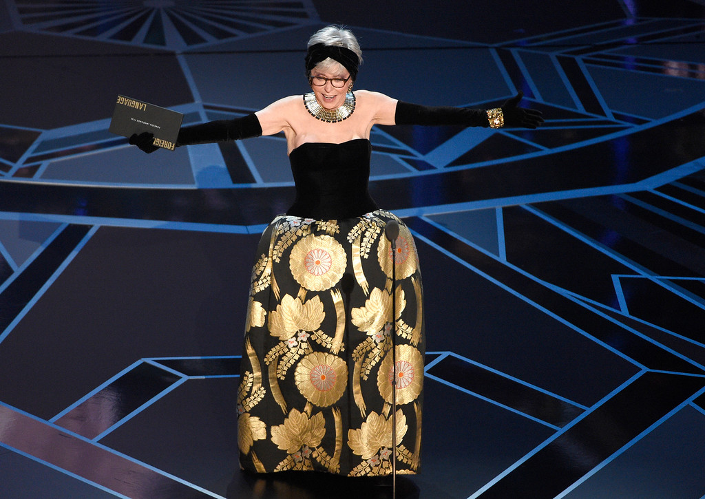 . Rita Moreno presents the award for best foreign language film at the Oscars on Sunday, March 4, 2018, at the Dolby Theatre in Los Angeles. (Photo by Chris Pizzello/Invision/AP)