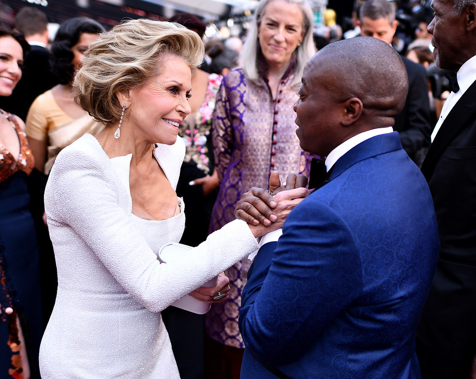 . Jane Fonda, left, greets Yance Ford at the Oscars on Sunday, March 4, 2018, at the Dolby Theatre in Los Angeles. (Photo by Charles Sykes/Invision/AP)
