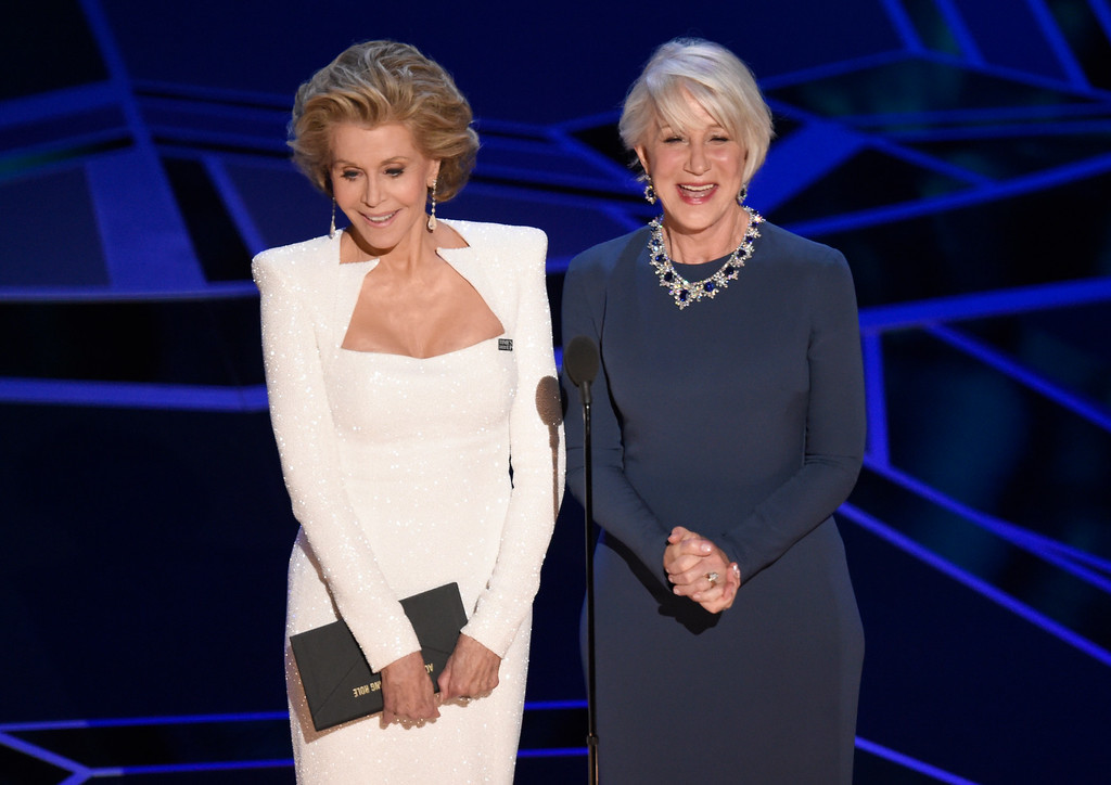 . Jane Fonda, left, and Helen Mirren present the award for best performance by an actor in a leading role at the Oscars on Sunday, March 4, 2018, at the Dolby Theatre in Los Angeles. (Photo by Chris Pizzello/Invision/AP)