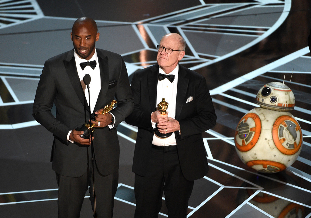 ". Kobe Bryant, left, and Glen Keane accept the award for best animated short for ""Dear Basketball\"" at the Oscars on Sunday, March 4, 2018, at the Dolby Theatre in Los Angeles. BB-8 appears on right. (Photo by Chris Pizzello/Invision/AP)"