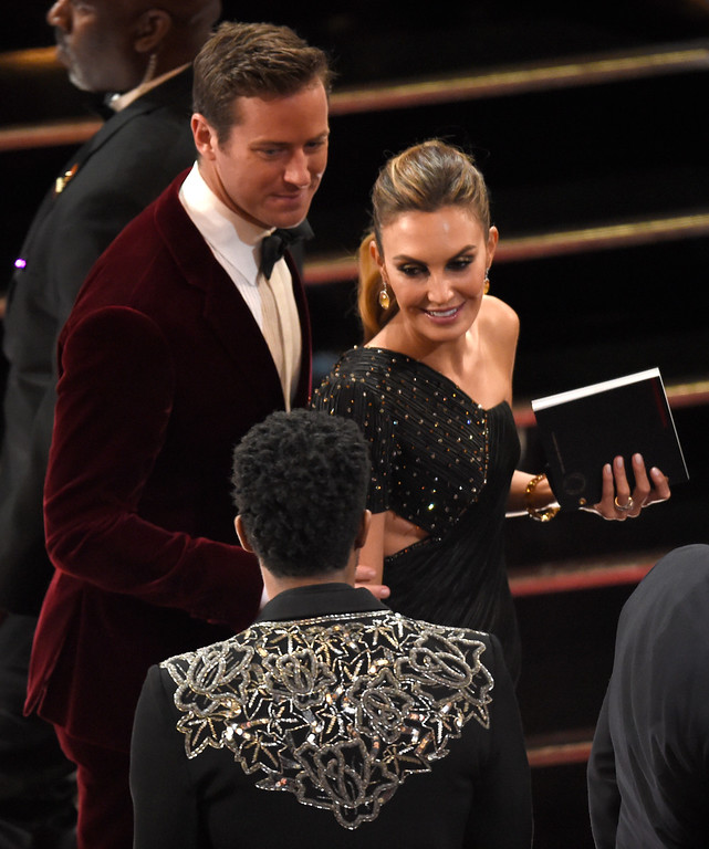 . Armie Hammer, left, and Elizabeth Chambers appear in the audience at the Oscars on Sunday, March 4, 2018, at the Dolby Theatre in Los Angeles. (Photo by Chris Pizzello/Invision/AP)