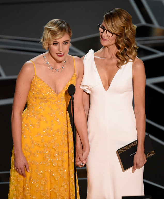 . Greta Gerwig, left, and Laura Dern present the award for best documentary feature at the Oscars on Sunday, March 4, 2018, at the Dolby Theatre in Los Angeles. (Photo by Chris Pizzello/Invision/AP)