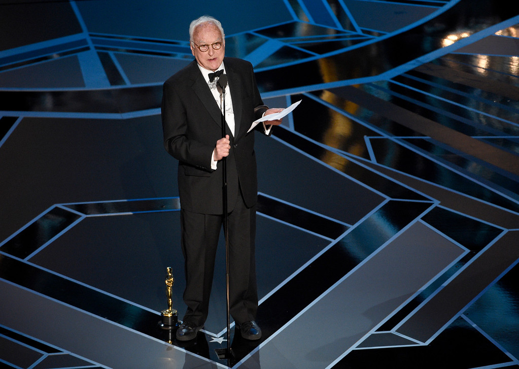 ". James Ivory accepts the award for best adapted screenplay for ""Call Me by Your Name\"" at the Oscars on Sunday, March 4, 2018, at the Dolby Theatre in Los Angeles. (Photo by Chris Pizzello/Invision/AP)"