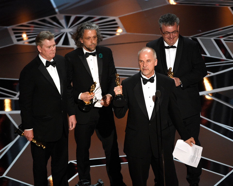". Richard R. Hoover, from left, Paul Lambert, John Nelson, and Gerd Nefzer accept the award for best visual effects for ""Blade Runner 2049\"" at the Oscars on Sunday, March 4, 2018, at the Dolby Theatre in Los Angeles. (Photo by Chris Pizzello/Invision/AP)"