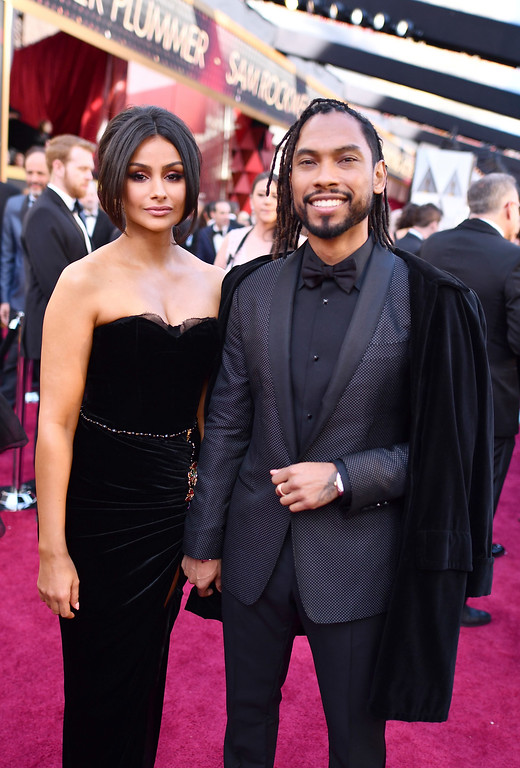. Nazanin Mandi, left, and Miguel arrive at the Oscars on Sunday, March 4, 2018, at the Dolby Theatre in Los Angeles. (Photo by Charles Sykes/Invision/AP)