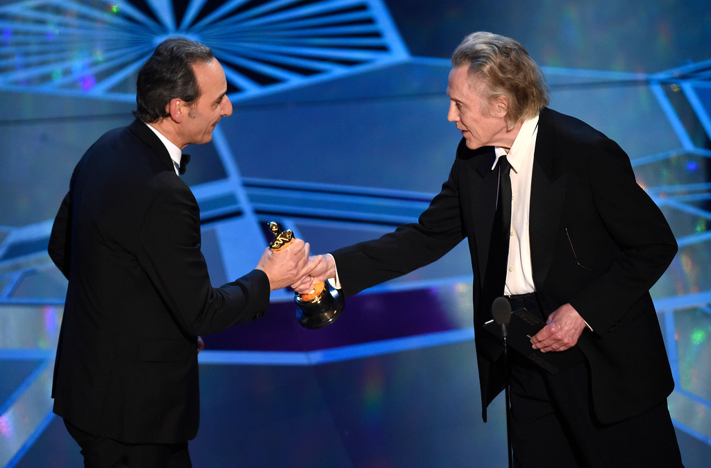 ". Christopher Walken, right, presents Alexandre Desplat with the award for best original score for ""The Shape of Water\"" at the Oscars on Sunday, March 4, 2018, at the Dolby Theatre in Los Angeles. (Photo by Chris Pizzello/Invision/AP)"