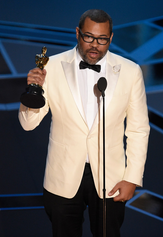 ". Jordan Peele accepts the award for best original screenplay for ""Get Out\"" at the Oscars on Sunday, March 4, 2018, at the Dolby Theatre in Los Angeles. (Photo by Chris Pizzello/Invision/AP)"