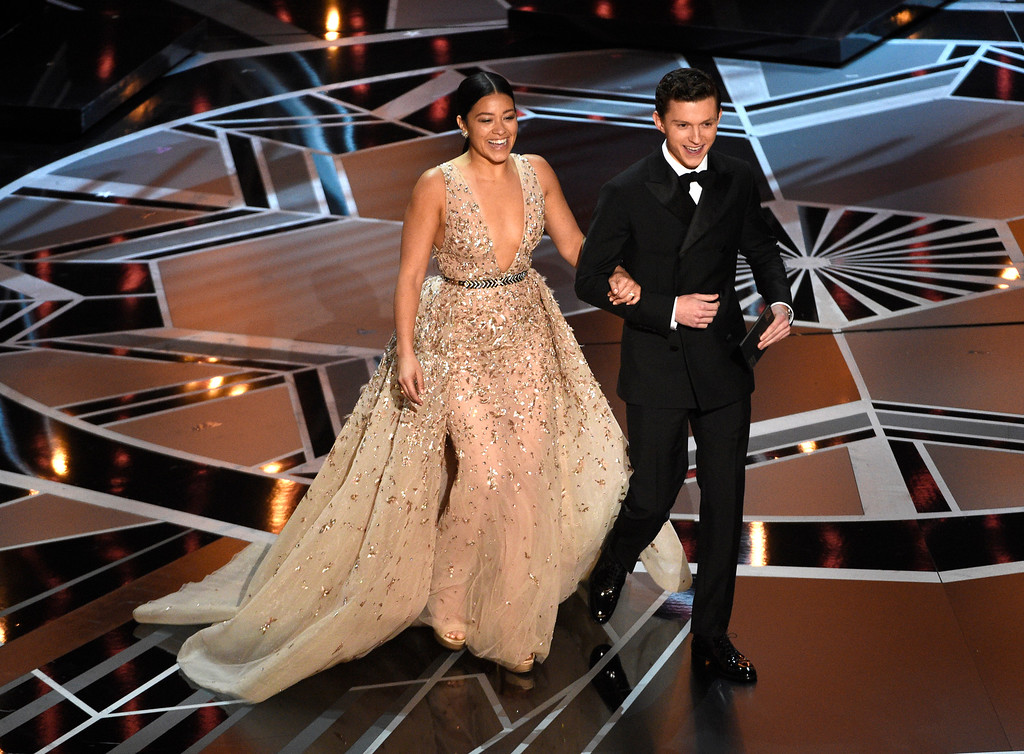 . Gina Rodriguez, left, and Tom Holland present the award for best visual effects at the Oscars on Sunday, March 4, 2018, at the Dolby Theatre in Los Angeles. (Photo by Chris Pizzello/Invision/AP)