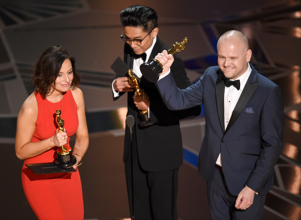 ". Lucy Sibbick, from left, Kazuhiro Tsuji, and David Malinowski accept the award for best makeup and hairstyling for ""Darkest Hour\"" at the Oscars on Sunday, March 4, 2018, at the Dolby Theatre in Los Angeles. (Photo by Chris Pizzello/Invision/AP)"