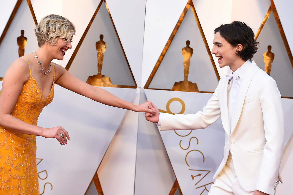 . Greta Gerwig, left, and Timothee Chalamet arrive at the Oscars on Sunday, March 4, 2018, at the Dolby Theatre in Los Angeles. (Photo by Jordan Strauss/Invision/AP)