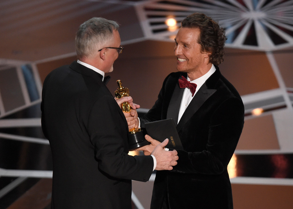 ". Matthew McConaughey, right, presents Lee Smith with the award for best film editing for ""Dunkirk\"" at the Oscars on Sunday, March 4, 2018, at the Dolby Theatre in Los Angeles. (Photo by Chris Pizzello/Invision/AP)"