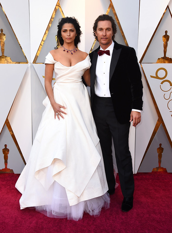 . Camila Alves, left, and Matthew McConaughey arrive at the Oscars on Sunday, March 4, 2018, at the Dolby Theatre in Los Angeles. (Photo by Jordan Strauss/Invision/AP)