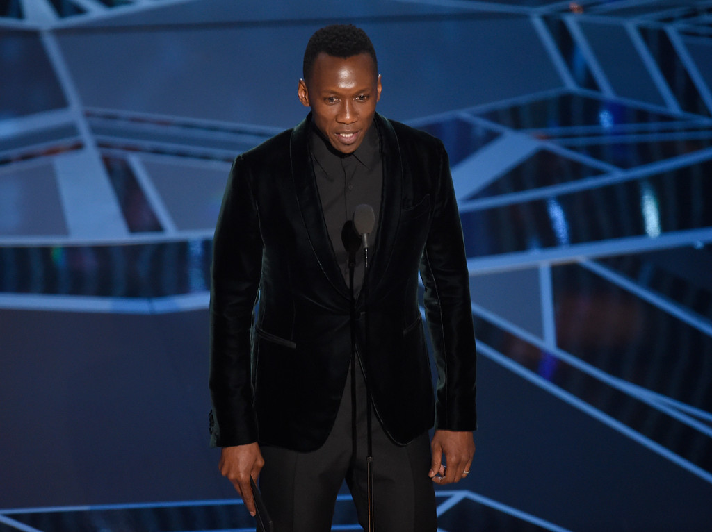 . Mahershala Ali presents the award for best performance by an actress in a supporting role at the Oscars on Sunday, March 4, 2018, at the Dolby Theatre in Los Angeles. (Photo by Chris Pizzello/Invision/AP)
