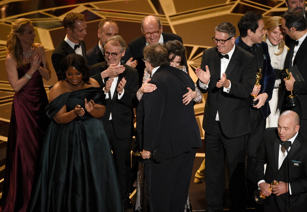 ". Guillermo del Toro and the cast and crew of ""The Shape of Water\"" accept the award for best picture at the Oscars on Sunday, March 4, 2018, at the Dolby Theatre in Los Angeles. (Photo by Chris Pizzello/Invision/AP)"