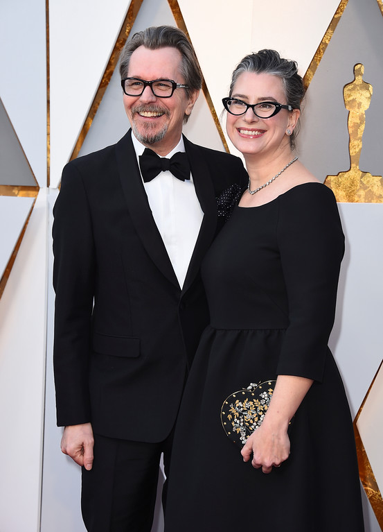 . Gary Oldman, left, and Gisele Schmidt arrive at the Oscars on Sunday, March 4, 2018, at the Dolby Theatre in Los Angeles. (Photo by Jordan Strauss/Invision/AP)