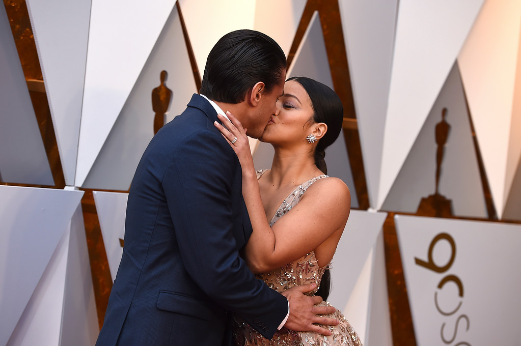 . Joe LoCicero, left, and Gina Rodriguez arrive at the Oscars on Sunday, March 4, 2018, at the Dolby Theatre in Los Angeles. (Photo by Jordan Strauss/Invision/AP)