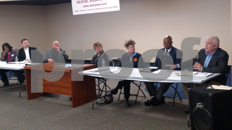 School board candidates Shatoya Black (from left), Jeromy Olson, Jeff Hallgren, Catherine Harned, Victoria Newport, Sean Johnson and Tracy Williams each expressed their views on local budget cuts during a Sunday forum hosted by the DeKalb Area Rental Association, held at 1500 Sycamore Road.