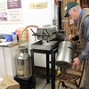 Kristi Garabrandt - The News-Herald<br /> Farmpark volunteer Gary Goodge runs the fresh boil syrup through a press to remove any minerals from trees.