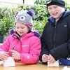 Kristi Garabrandt - The News-Herald<br /> Jared Cottrell, 8, and his sister Julia, 6, make mukuk (bark) buckets.