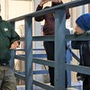 Kristi Garabrandt - The News-Herald<br /> Sean, 4, Mayfield Heights, watches as Farmpark event manager Andy McGovern explains that it takes 40 gallons of sap to make one gallon of maple syrup.