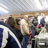 Kristi Garabrandt - The News-Herald<br /> Visitors to the Farmpark during Maple Sugaring Weekend line up to buy maple syrup, stirrers, and maple candy.