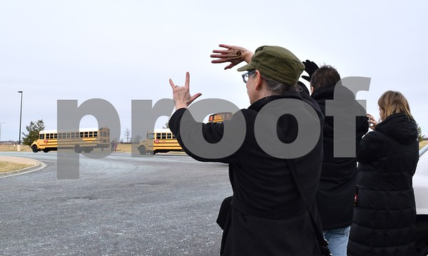 On Sunday, March 12, parents wave goodbye to the 102 members of the DeKalb High School Marching Barbs and 11 chaperones headed to O'Hare International Airport in Chicago. Once in Chicago, the group will board a plane for an eight-day trip to Ireland, where they will perform in the St. Patrick's Festival Parade in Dublin on Friday, March 17.