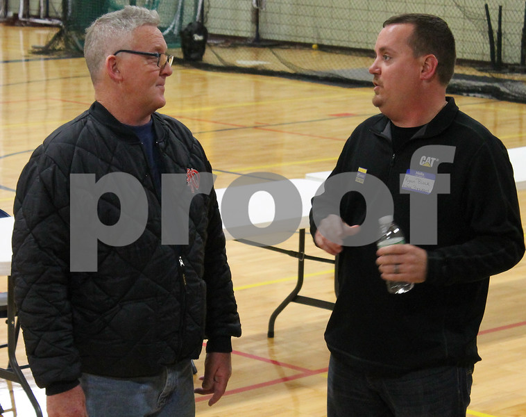 "Randy Butts of Kirkland, 54, left, speaks with village president candidate Ryan Block at the ""Meet the Candidates"" night on Tuesday, March 14, 2017 at Hiawatha High School in Kirkland.  Deanna Frances for Shaw Media"
