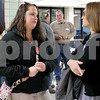 "Sarah Ziegler, village trustee candidate, right, speaks with Natasha Nellans of Kirkland, 23, center, at the ""Meet the Candidates"" night on Tuesday, March 14, 2017 at Hiawatha High School in Kirkland. Deanna Frances for Shaw Media"