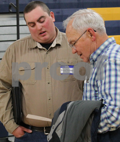 """Blake Bratcher, highway commission candidate, left, speaks to Ed Davis of Kirkland, 76, at the """"Meet the Candidates"""" night on Tuesday, March 14, 2017 at Hiawatha High School in Kirkland.  Deanna Frances for Shaw Media"""