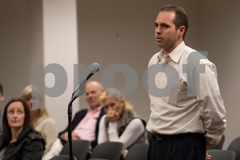 """Sam Buckner for Shaw Media.<br /> A representative from """"2022"""" LLC talks about the location of the proposed medical marijuana dispensary during a planning meeting on Monday, March 13, 2017 in Sycamore."""