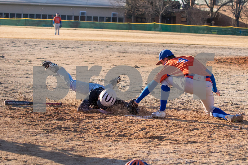 Sam Buckner for Shaw Media.<br /> Jordan Wortman gets tagged out by Nick Gargani while trying to steal home after a drop third strike was thrown to first base on Wednesday March 14, 2018.